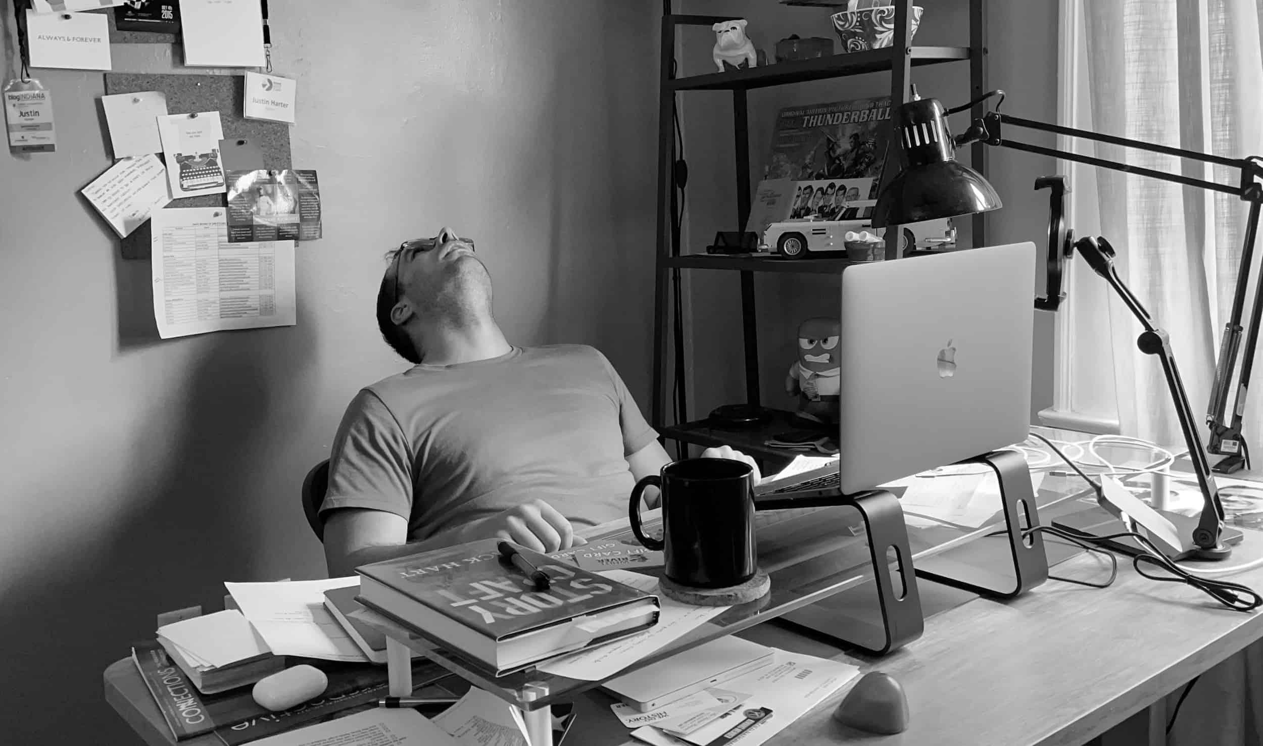 Photo of Justin at his desk
